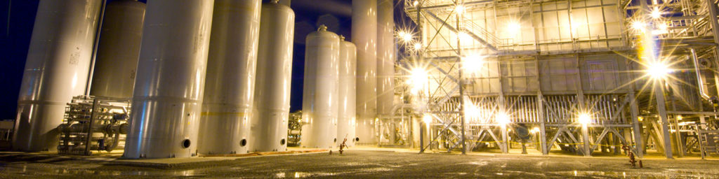 Nighttime photograph of the outside of a plant that leverages Rotoflow turbomachinery